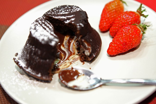 A warm chocolate fondant with a molten stream of striped chocolate lava. Photo: Vincent Bourdon